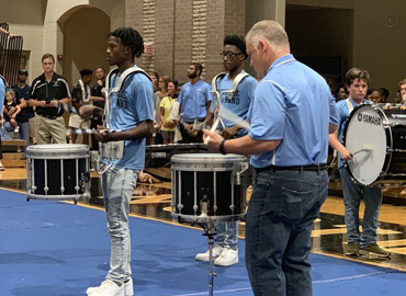 Northridge principal Dr. Evans plays with high school band