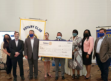 Dr Daria accepts check from Rotary Club of Tuscaloosa