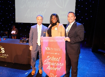 Westlawn principal accepts School Showcase Award