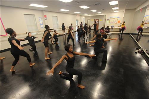 Dancers practicing in dance studio