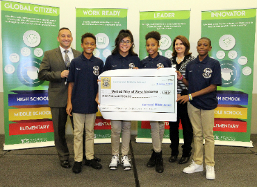 Dr. Daria & EMS Students present check to United Way