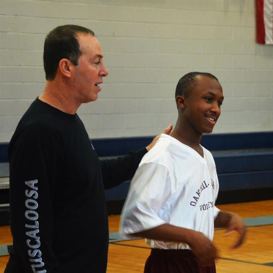 Coach Pete with team member Jamarcus Stubbs